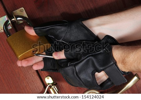 Robber breaks castle in door close-up - stock photo