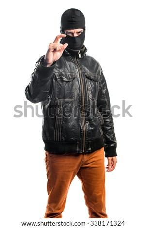 Robber doing tiny gesture - stock photo