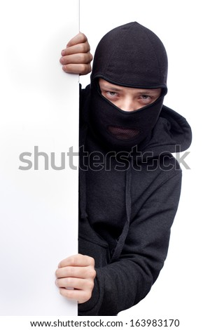 Robber hiding behind a empty white sign with space for text - stock photo