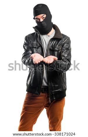 Robber holding something - stock photo
