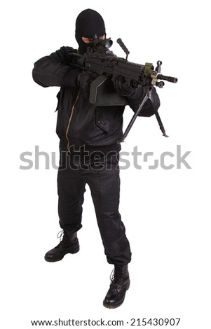 robber in black uniform and mask with machine gun
