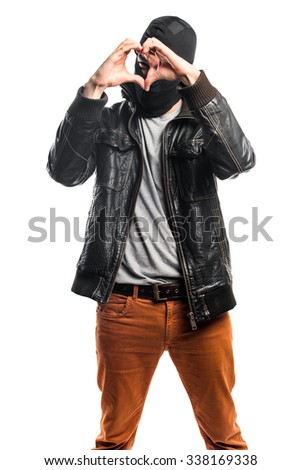 Robber making a heart with his hands - stock photo