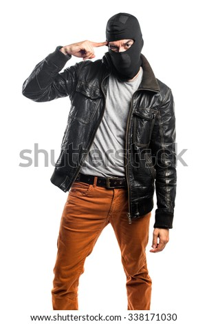 Robber making crazy gesture - stock photo