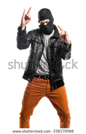 Robber making horn gesture - stock photo