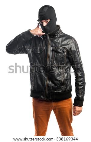 Robber making phone gesture - stock photo