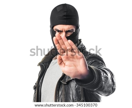 Robber making stop sign
