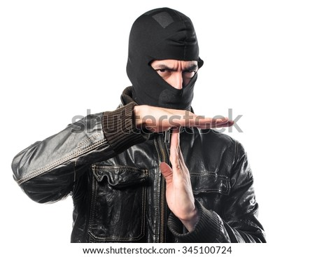 Robber making time out gesture