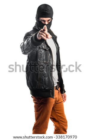 Robber pointing to the front - stock photo