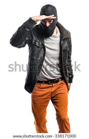 Robber showing something - stock photo
