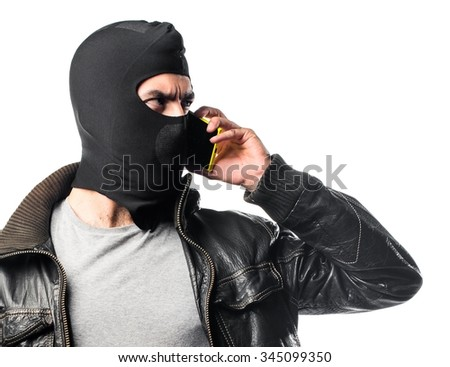Robber talking to mobile