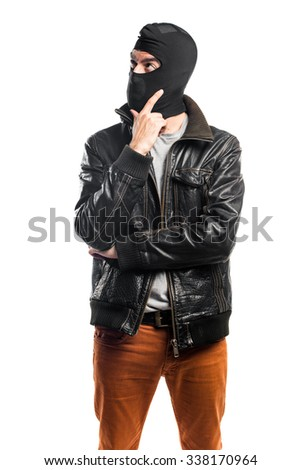 Robber thinking - stock photo