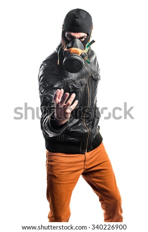 Robber with gas mask - stock photo