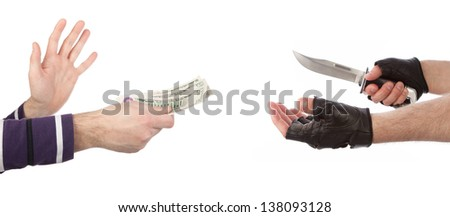 Robber with knife taking money from victim against a white background - stock photo
