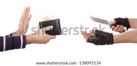 Robber with knife taking wallet from victim against a white background - stock photo