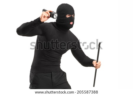 Robber with mask holding a flashlight and piece of pipe isolated on white background - stock photo
