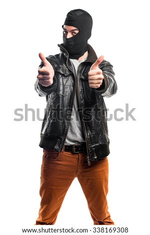 Robber with thumb up - stock photo