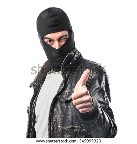 Robber with thumb up