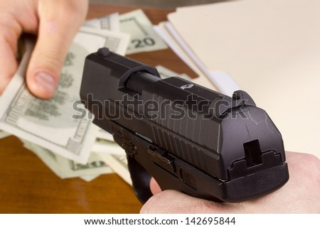 Robbery with the use of a gun in the office. - stock photo