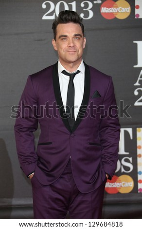 Robbie Williams arriving for the Brit Awards 2013 at the O2 Arena, Greenwich, London. 20/02/2013 Picture by: Henry Harris - stock photo