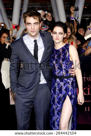 Robert Pattinson and Kristen Stewart at the Los Angeles premiere of 'The Twilight Saga: Breaking Dawn Part 1' held at the Nokia Theatre L.A. Live in Los Angeles on November 14, 2011.  - stock photo