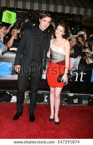 "Robert Pattinson & Kristen Stewart arriving to the World Premiere of ""Twilight"" at Mann's Village Theater in Westwood, CA November 17, 2008 - stock photo"