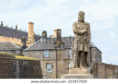 Robert the Bruce, king of Scots; stone statue in front of Stirling castle. Scotland - stock photo