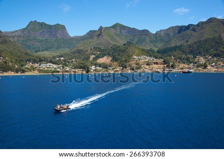 ROBINSON CRUSOE ISLAND, CHILE - MARCH 15, 2015: Panoramic view of Cumberland Bay and the small town of San Juan Bautista on Robinson Crusoe Island in Chile - stock photo