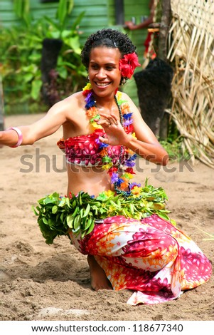 ROBINSON CRUSOE ISLAND, FIJI - OCT 29: Island dancer performs traditional dance exhibition on Robinson Crusoe Island, October 29, 2012 - stock photo