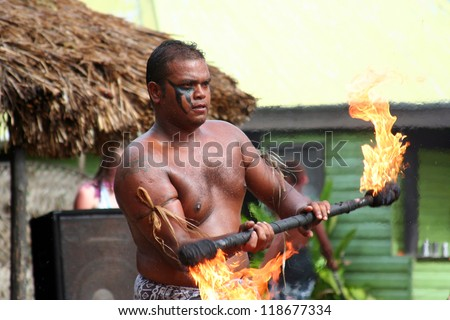 ROBINSON CRUSOE ISLAND, FIJI - OCT 29: Island dancer performs traditional fire dance exhibition on Robinson Crusoe Island, October 29, 2012 - stock photo