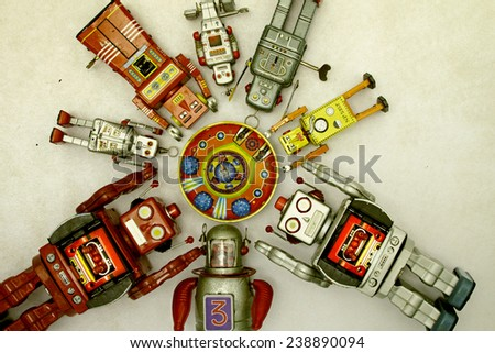 robot gather round there mother ship  - stock photo