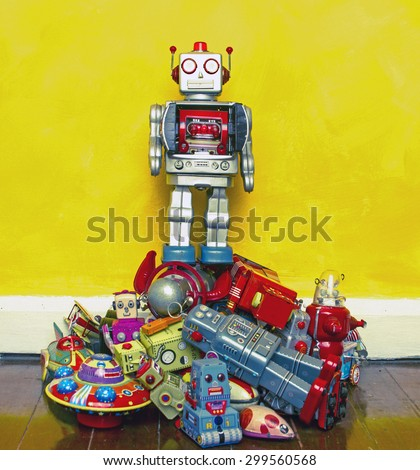 robot toy stands on the oppresed  - stock photo