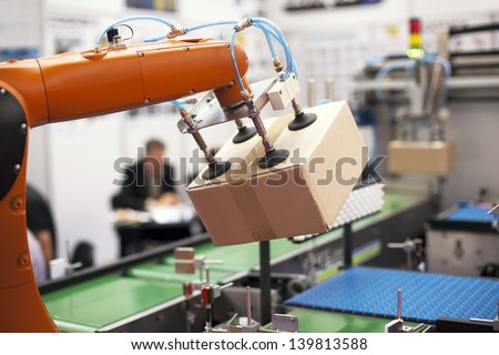 Robotic arm for packing - stock photo