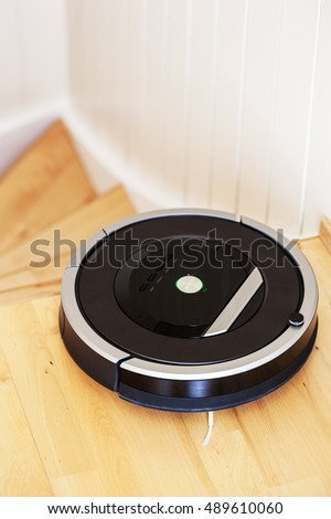 robotic vacuum cleaner on laminate wood floor smart cleaning technology stairs