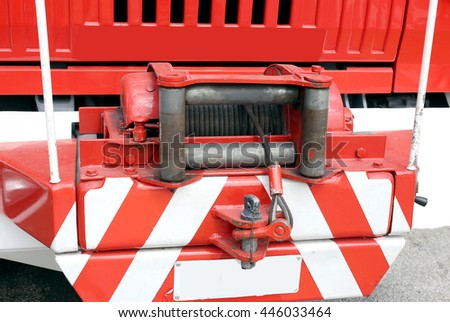 robust hoist with steel ropeinstalled on a big fire truck - stock photo