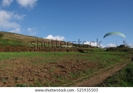 ROCCA PRIORA, ITALY - NOVEMBER 1, 2016: paragliding lesson,  paraglider landing after a training flight