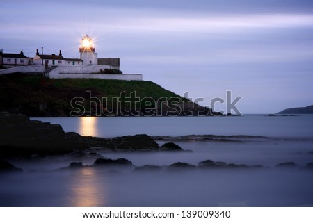 Roches Point Lighthouse at Dusk - stock photo