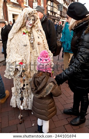 ROCHESTER, UK-DECEMBER 6: A women dressed as Miss Havisham parades in the streets surrounded by visitors, in the annual Rochester Dickensian Christmas Festival,   December 6, 2014, Rochester UK. - stock photo