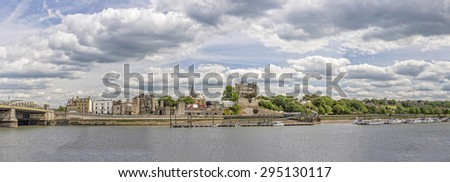 Rochester, United Kingdom - May 28, 2015: Panoramic view to Rochester city with medieval structures, bridge, river and clouds