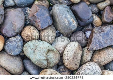 Rock Abstract, colorful rocks closeup at the beach - stock photo
