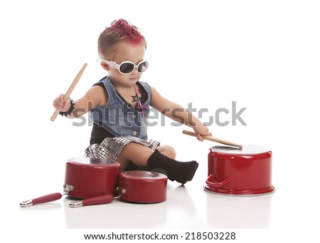Rock and Roll Baby!  Adorable toddler with a pink mohawk and banging on pots and pans.  Isolated on white with room for your text.  - stock photo