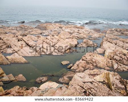 Rock and sea, at HK, China - stock photo