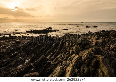 Rock and sea morning  light in Thailand - stock photo