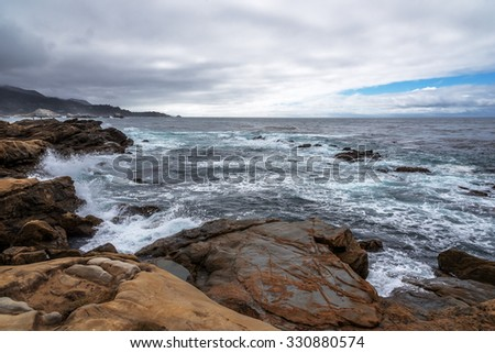 Rock and unusual geological formations at low tide, along the rugged Big Sur coastline, near Monterey, CA. on the California Central Coast. - stock photo