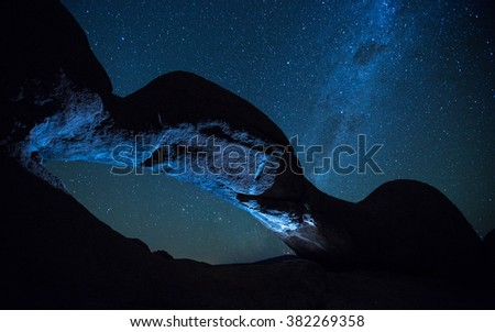 Rock Arch and night sky at Spitzkoppe in Namibia - stock photo