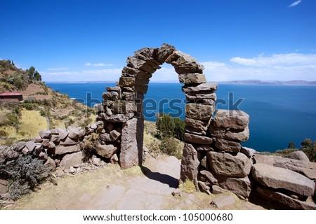 Rock Arch on Taquile Island , Puno, Peru - stock photo