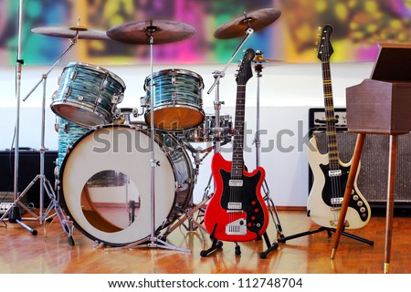 Rock Band Instruments, best focus on red guitar - stock photo
