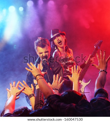 Rock band live. Band on Stage performing for his fans - stock photo