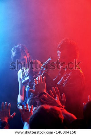 Rock band live. Rock star singer on stage - stock photo