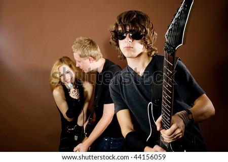 Rock band performance in studio - stock photo