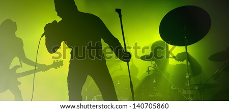 Rock band performing live show - stock photo